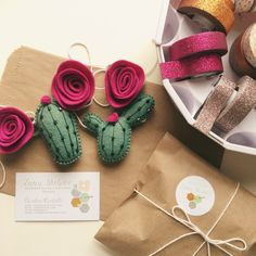 This listing is for a felt cactus and flower garland. It includes two different felt cacti strung between three fuchsia felt flowers. The string is a soft yet durable cotton twine. The twine is 3 feet in length and the pieces can be adjusted as desired. Each item is cut from an original