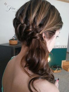 Braided to the side with curls