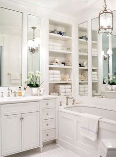 Ashley Whittaker Design   Chic White Bathroom With Marble Basketweave Tiles  Floor + Mirrored Walls + Built Ins