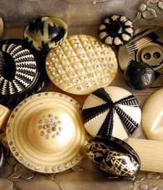 ---vintage, black and white celluloid buttons.