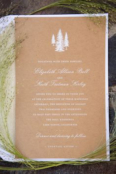 The couple's forest-inspired wedding invitations featured a pine tree motif and were printed on natural-brown paper with white lettering. #weddinginvitation Photography: Catherine Hall Studios. Read More: http://www.insideweddings.com/weddings/rustic-classic-summer-wedding-in-lake-tahoe-california/645/