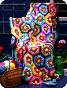 Any of my friends/family out there who know how to crochet want to make a crazy bright throw like this for me? :-)