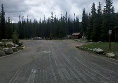 Photo of the Long Lake Trailhead Parking Lot with bathrooms and picnic tables