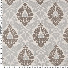 the accent fabric for our living room.  It's being used to upholster an ottoman, for throw pillows, and for a sleek and simple cornice board.