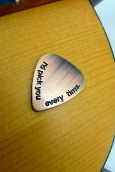 This listing is for a hand stamped antiqued copper guitar pick as a keychain. It is stamped with 'I'd pick you every time'. The copper is very sturdy and will last the test of time. We can make this into a necklace, keychain or bracelet for you.