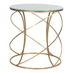 Twisted ironwork accent table in gold with a glass top.    Product: Accent tableConstruction Material: Iron an...