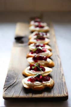 Canapes - buy a pack of mini bruschettas. Spread with Philadelphia soft cheese and top with beetroot relish. (Waitrose do a good beetroot one). Garnish with finely chopped water cress or sliced lettuce leaf.