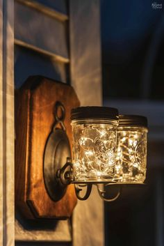 These solar mason jar lights are an easy DIY that add a little magic to your deck or patio at night! All you need are sconces, mason jars and solar lights! Mason Jar Solar Lights, Mason Jar Lighting, Mason Jar Lamp, Pot Mason Diy, Pots Mason, Solar Licht, Diy Lampe, Solar Light Crafts, Glass Bottle Crafts
