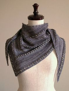 I love stockinette stitch to show off pretty yarns, and love simple knits for mindless knitting.  This one looks nice with the beads in the eyelets.