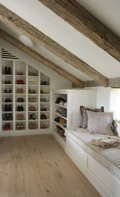 Clever Attic Storage IdeasAttic Closet Ideas - Walk-in attic wardrobe includes a sloped ceiling lined with rustic timber light beams over angled built in footwear cubbies and sweatshirt racks beside a window seat. Attic Master Bedroom, Attic Bedroom Designs, Attic Bedrooms, Attic Design, Bedroom Loft, Design Bedroom, Attic Bedroom Decor, Bedroom Curtains, Master Suite
