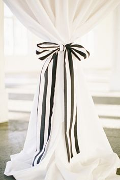 This would be cute to do to curtains in my house. You can even change the ribbon for different seasons!