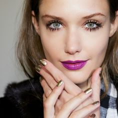 Purple lips, gold nails, and lush lashes at Nanette Lepore fall 2015