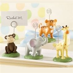 Born To Be Wild Animal Place Card/Photo Holders (Set of Four Assorted) - Featuring an assortment of 4 colorful, resin baby jungle animals, our Born To Be Wild Animal Place Card/Photo Holders make the perfect party favors for baby showers, kids birthday parties and more. Each set of four comes with a giraffe, an elephant, a tiger and a monkey on green pedestals with a metal place card / photo holder (place cards not included).