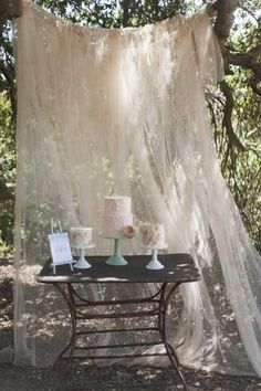 Tulle cake table backdrop. via Creative Cake Tables / Wedding Style Inspiration / LANE (PS join us on Facebook: www.facebook.com/thelane)