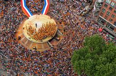 National pride: The Dutch Olympic can be seen standing on a stage created to look like a gold medal as crowds cheered in Den Bosch, the Netherlands.  Olympics 2012