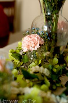 Garden Party Decor- using mason jars and grocery store flowers. NOT carnations tho- Cover table in craft paper and burlap ribbon strips