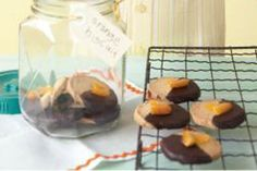 These elegant biscuits, fragrant with orange zest and dipped in dark chocolate, are the perfect edible gift or dinner party grand finale.