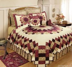Dahlia Quilt ~   An exquisitely pieced medallion quilt anchored with a blooming dahlia of diminutive florals and paisley prints captured in shades of burgundy, rose and antique neutrals. A sawtooth border echoes hand quilted squares and finishes the quilt with high drama.