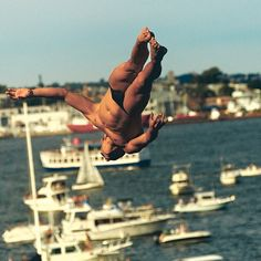 """victoryjournal """"Seaside landscapes make some men crazy, pushing them to engage with edges-of-the-earth in strange ways. #Cliffdivers tackle these borders by forcefully erasing them. They're sportsmen, artists, and daredevils, conjurers of the miraculous and the awe-inspiring through willpower and craft."""" From """"Leap of Faith."""" (: @anthonyblaskophoto + : @raspberryjones) #VictoryJournalFive #Water #Diving #RedBullCliffDiving #Boston 2016/10/07 06:09:41"""