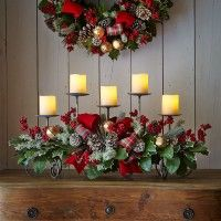 Furniture and Accessories. Remarkable Rustic Natural DIY Christmas Centerpiece and Wall Decorations with Beautiful Wreath, and Antique Iron Candle Holder Decorated with Greenery, Pinecones, Berries, Nice Small Jingle Bells and Lovely Red Ribbons. Fresh Natural Greenery for Simple yet Beautiful Christmas Centerpieces