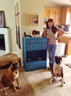DIY pet feeding station out of an old dresser. Dogs on bottom, cats on top, plenty of storage. ....this is kind of awesome, we could do just the cats on top and all the pet equipment in the drawers with a slightly lower dresser so the cat food can't be reached by the baby.