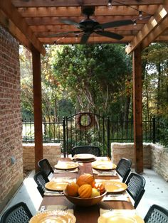 Outdoor Dining Room with Rustic table for 10.  This patio was designed and constructed by the Western Patio Company, located in Spring, Texas.  Rustic Outdoor Living...Texas Style.