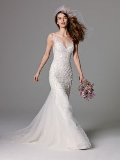 Such a stunningly dramatic Watters gown from Low's Bridal and Formal. Click the image for more information about Low's.