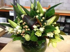 Flower Arrangement featuring Hypericum Coco Sovereign spotted at Pearson's Florist in Sydney.