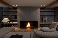 20 Of The Most Amazing Modern Fireplace Ideas interior corrugated material is cool. also having an enormous fireplace with center wood looks surprisingly nice.