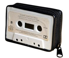 This case/wallet is made using an old music cassette. A great gift for music lovers or anyone who wants to get nostalgic. Using YKK zipper closure Dimensions Length in inches: Lenght 4.1 X Height 2.7  X Width 1.4 Length in centimeters: 10.5 cm X Height 6.8 cm X Width 3.5 cm  Also available in a larger cassette bag here:  https://www.etsy.com/il-en/listing/486959101/cassette-cross-body-bag-upcycled?ref=shop_home_active_56 ********************************...