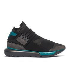 """Qasa high sneakers from the F/W2016-17 Y-3 by Yohji Yamamoto collection in black Launched in 2002, Y-3 is Yohji Yamamoto's clothing line made in collaboration with Adidas: the """"Y"""" represents the Japanese designer while 3 is for the three unmistakable stripes, logo of the sports brand. Yamamoto's visions and innovations join Adidas' technologies, for a cherished cutting edge final product. These Qasa High sneakers are from Y-3 new collection, Yohji Yamamoto's clothing brand made in…"""