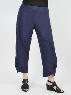 A pair of slightly cropped high rise trousers feature a tulip silhouette, wide waistband, invisible front and small gathered architectural tucks at hemline to create a beautiful form. Tulip, Hemline, Capri Pants, Trousers, Silhouette, Create, Clothes, Beautiful, Fashion