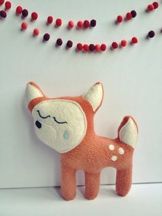 is it a fox? is it a deer? maybe its both! one thing is certain, she is ready to ship. she is made from fleece, felt & polyfil. her face also has hand embroidered features. all my plushes are unique and handmade with lots of love & care.