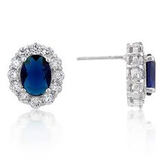 Genuine Rhodium Plated Oval Sapphire Blue Crystal and Round Cubic Zirconia Trimmed Earrings with Pave Shoulders Polished into a Lustrous Silvertone Finish
