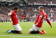 Manchester United's Wayne Rooney (R) celebrates with his teammate Rafael Da Silva after scoring a goal against West Ham United during their English Premier League soccer match at Old Trafford in Manchester, northern England September 27, 2014.   REUTERS-Darren Staples