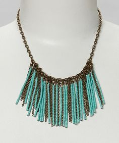 Take a look at this Bronze & Turquoise Seed Bead Fringe Bib Necklace by Berry Jewelry on #zulily today!