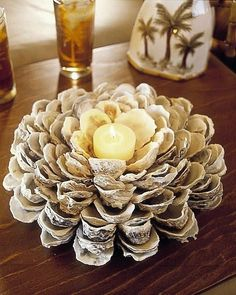 now I just need to find a million Oyster Shells. oyster shell candle holder (DIY directions) - this might look pretty with blue mussel shells too! Oyster Shell Crafts, Oyster Shells, Sea Shells, Seashell Crafts, Beach Crafts, Seashell Candles, Beach Cottage Decor, Coastal Decor, Shell Centerpieces