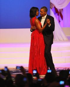 US President Barrack Obama  dancing with the First Lady Michelle  Obama