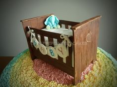 Cradle cake - I made this cake for my friends babyshower, with the help of a tutorial by McGreevy Cakes :) All parts are edible, except for the cakeboard and the support underneath the crib. Decorations are made of fondant with tylose added, the rug is buttercream