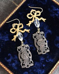 The elaborate Paris components in these gorgeous earrings are salvaged from an antique France souvenir bracelet. The brass ribbon bow is also a beautiful component, along with the clear cut glass bead. These stunning, but neutral earrings are head turners. These are so beautiful with just