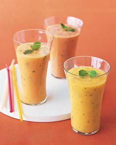 Papaya-Ginger Smoothie    Ingredients     2 1/2 cups papaya (Solo or Mexican) chunks   1 cup ice cubes   2/3 cup nonfat plain yogurt   1 tablespoon finely chopped peeled fresh ginger   1 tablespoon honey   Juice of 2 lemons   16 fresh mint leaves, plus 4 sprigs for garnish       Directions    1.  Refrigerate papaya until very cold, at least 1 hour or overnight.     2.  Blend papaya, ice, yogurt, ginger, honey, and lemon juice in a blender.
