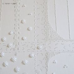 Paper embroidery by C. Karen Ruane.  Her work is beautiful ... I love the white on white.