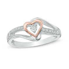 Diamond accent heart promise ring , sterling silver and 10K rose gold. Size 7