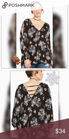 Torrid Floral Paisley Cold Shoulder Top black jersey knit , soft and stretchy with a floral and paisley print is straight out of a bohemian dream. The cold shoulder cutouts are ideal for flashing some skin, as is the strappy v back /rayon spandex torrid Tops