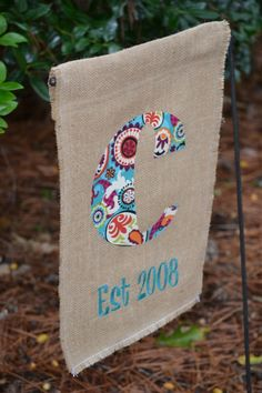 Embroidered burlap garden flag....cute, but you would have to do this two layers so that the back side was cute too