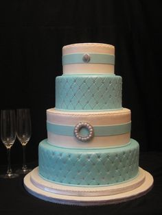 Blue, silver and white cake for special occasions.