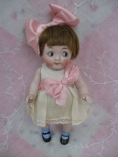 Antique Kestner googly bisque doll, side glance, colored glass sleep eyes.