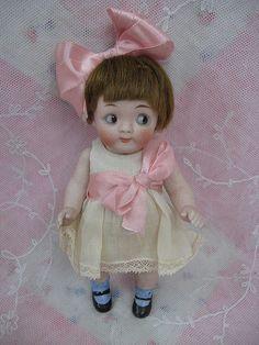Antique Kestner googly bisque doll, side glance, colored glass sleep eyes.