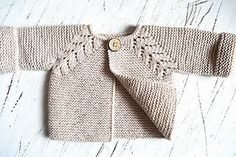 Ravelry: Elif0427's Ruffle baby vest   with right side to be completed, a work in progress.