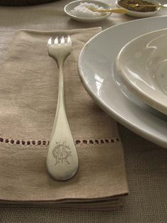 "I love mixing silverware, all with different monograms, whenever I set a table. Check out this Christophle fork with an elegant ""MG"" monogram on the back. (My good friend Michael Gorman has been trying to get me to give this set to him for years, but I just can't part with it!)  Doesn't it look chic on this hemstitched napkin from Target?"